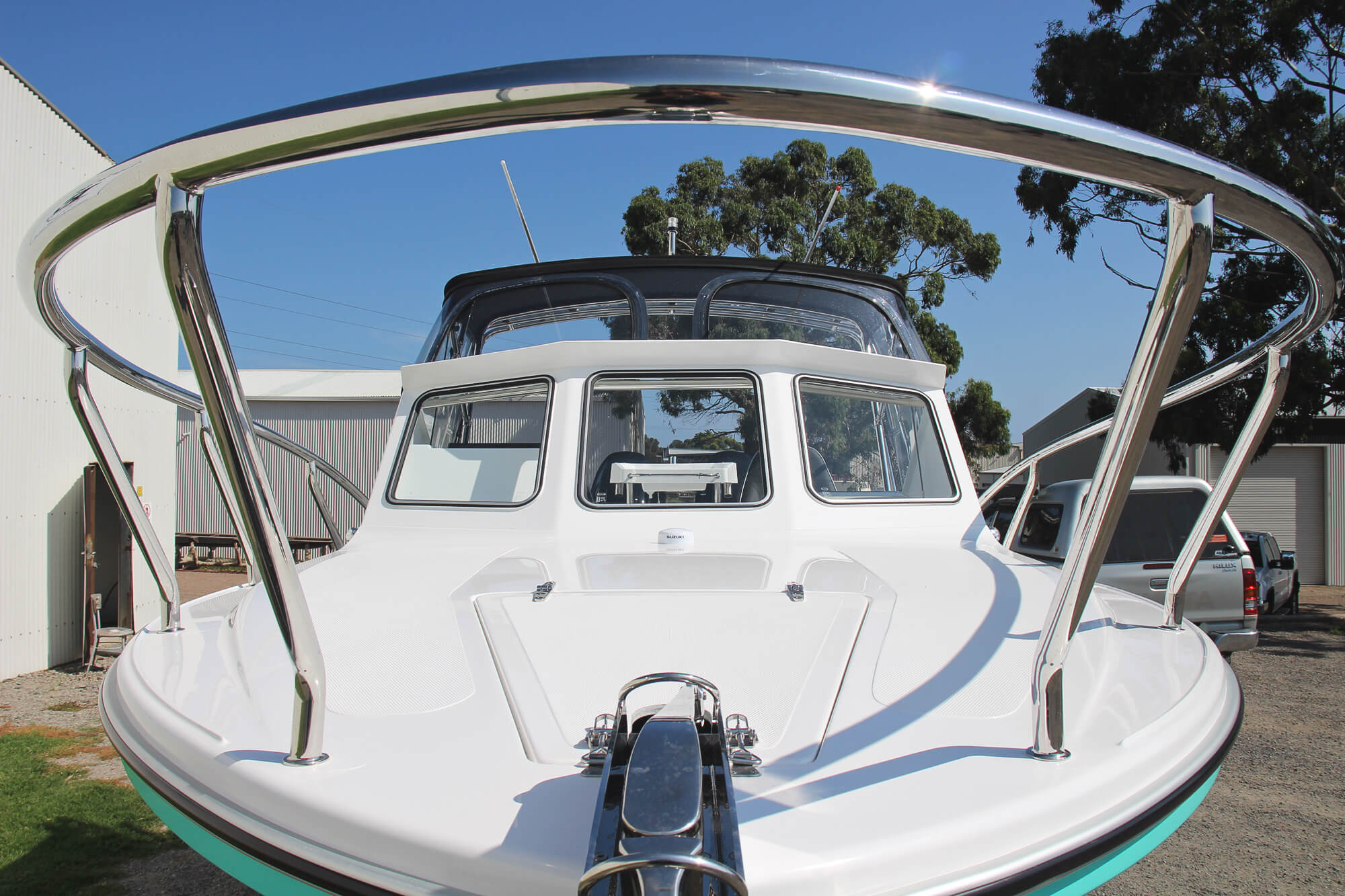 Stainless bow rail, top deck & wavebreaker on Edencraft 233 Formula Classic