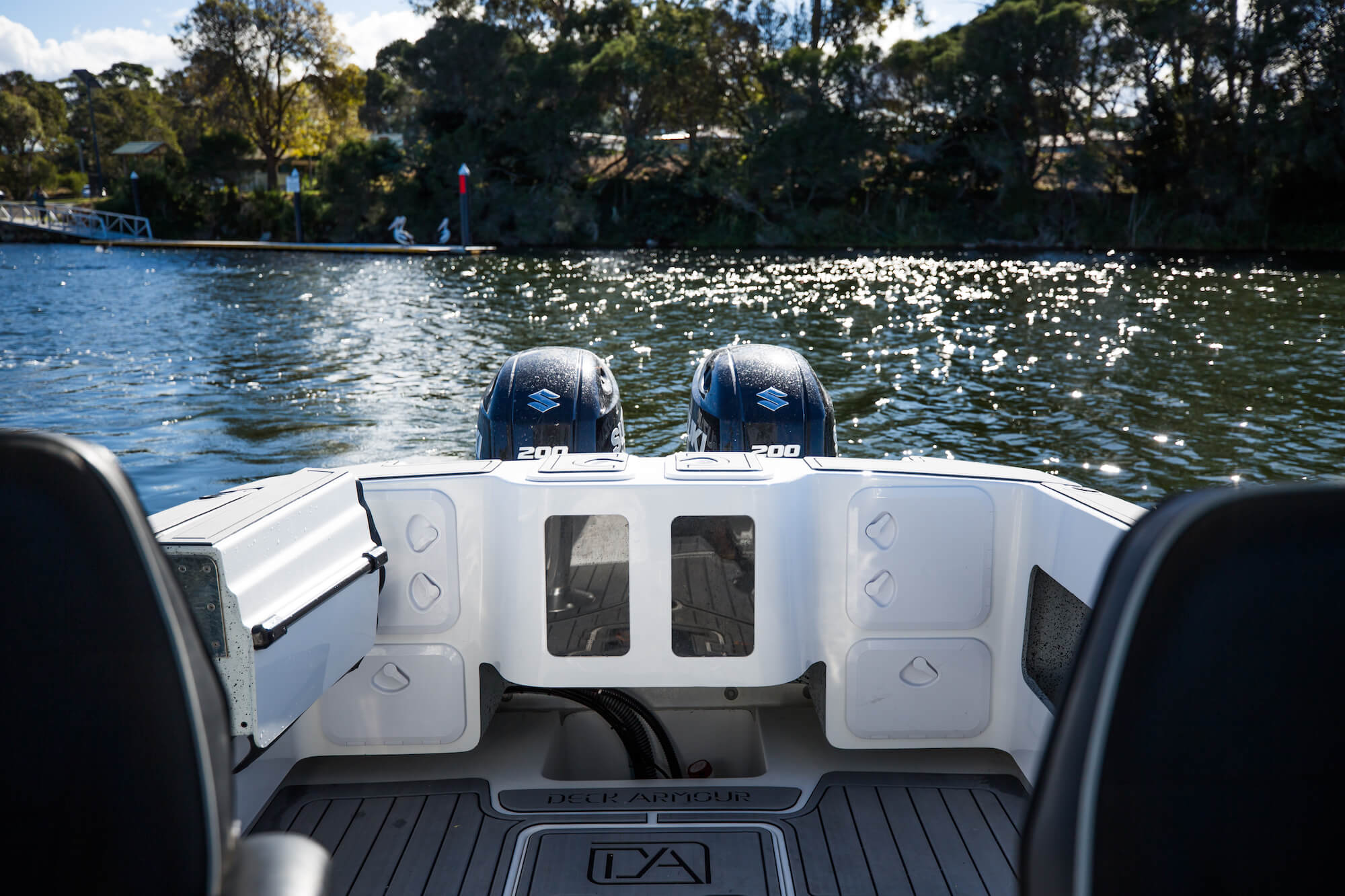 Stern of the Edencraft 233 Formula Platinum boat with twin live bait tanks and storage pockets